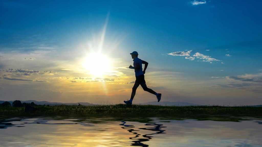 Man running by lake