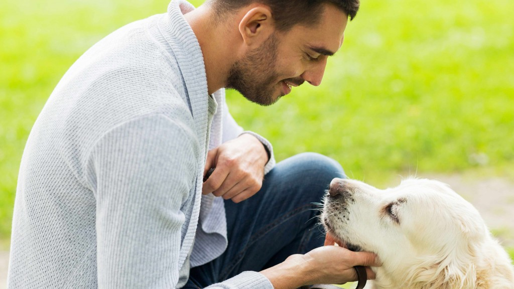a young man petting his dog