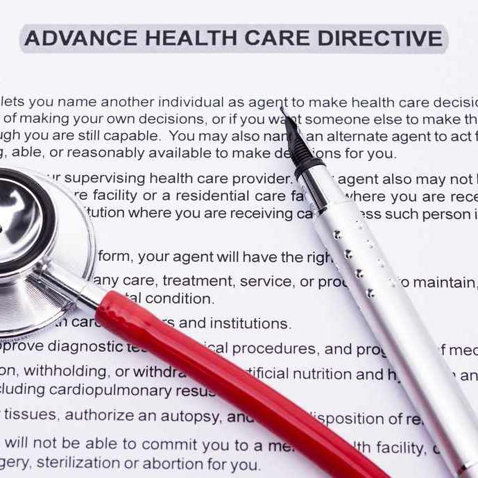 advance directive paperwork, with a stethoscope and fountain pen