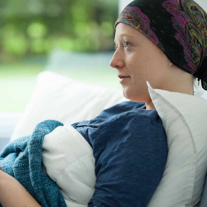 cancer patient, lying down, being comforted