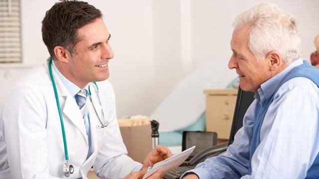 a man talking with a doctor