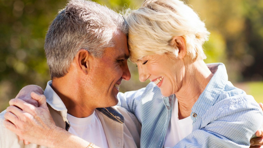 middle-aged couple outside hugging in the sunshine