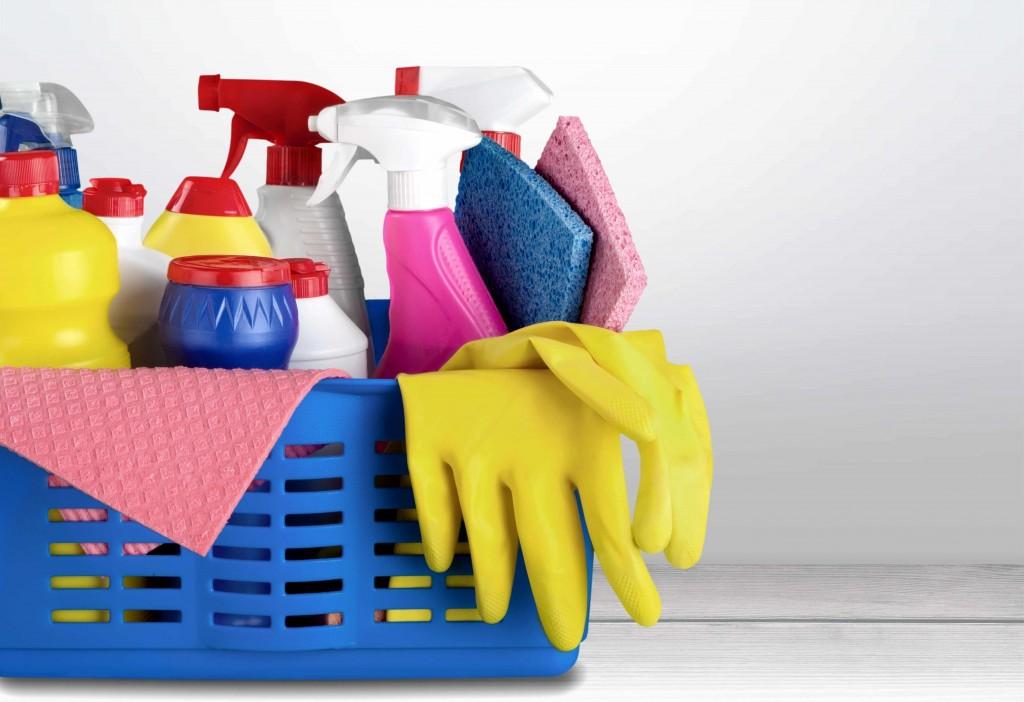 kitchen basket of cleaning supplies, spray bottles, chemicals