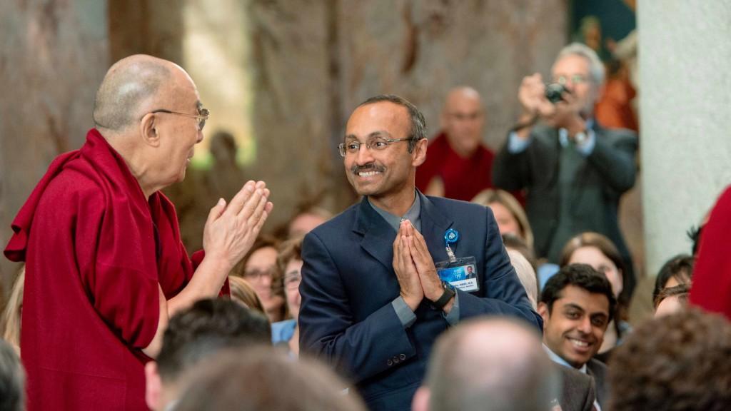 the Dalai Lama at Saint Marys Chapel greeting an employee