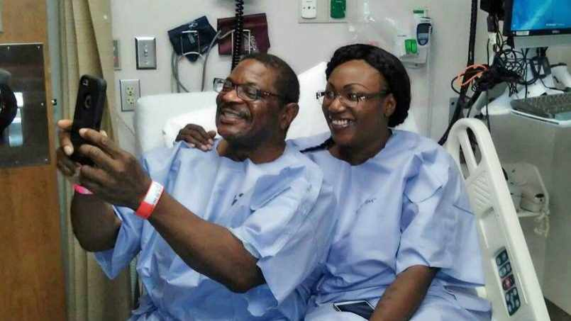 two transplant patients in hospital room taking selfie picture on phone