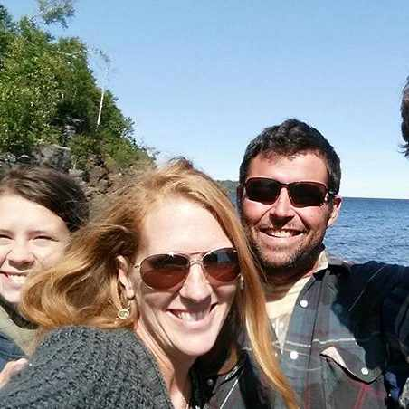 cancer patient Bonnie Dinneen Hedrick with her family on the lakeshore