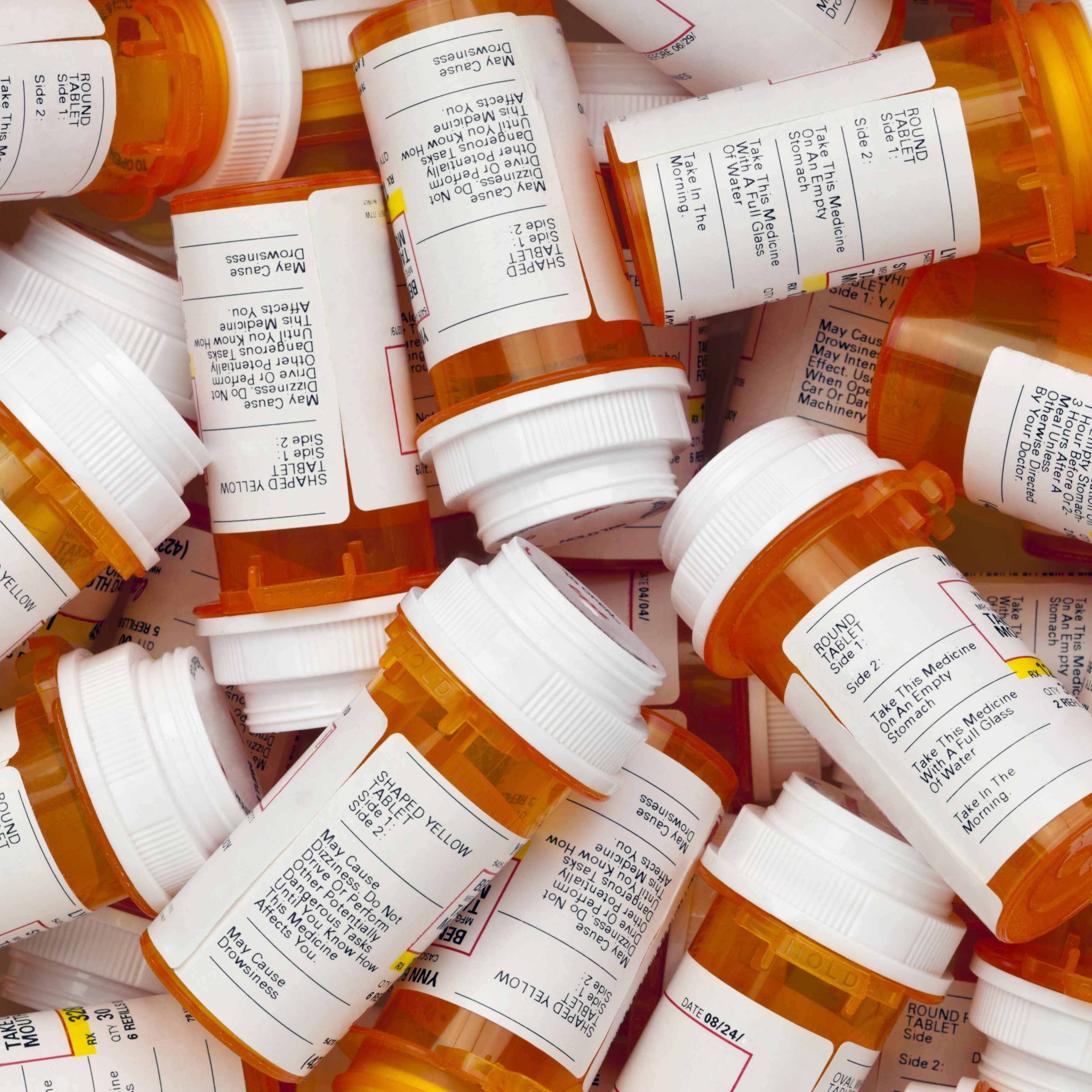 a collection of prescription pill bottles