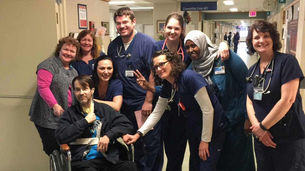 a group of Mayo Clinic nurses and medical staff in hospital hallway with patient Randy Marlow