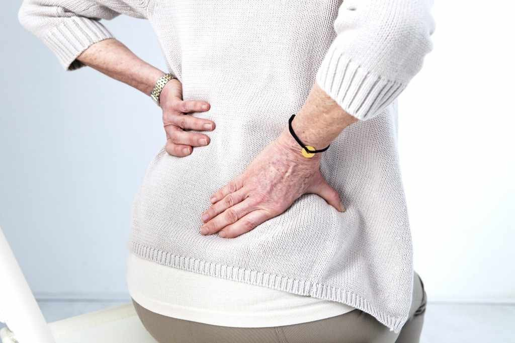 older woman with low back pain