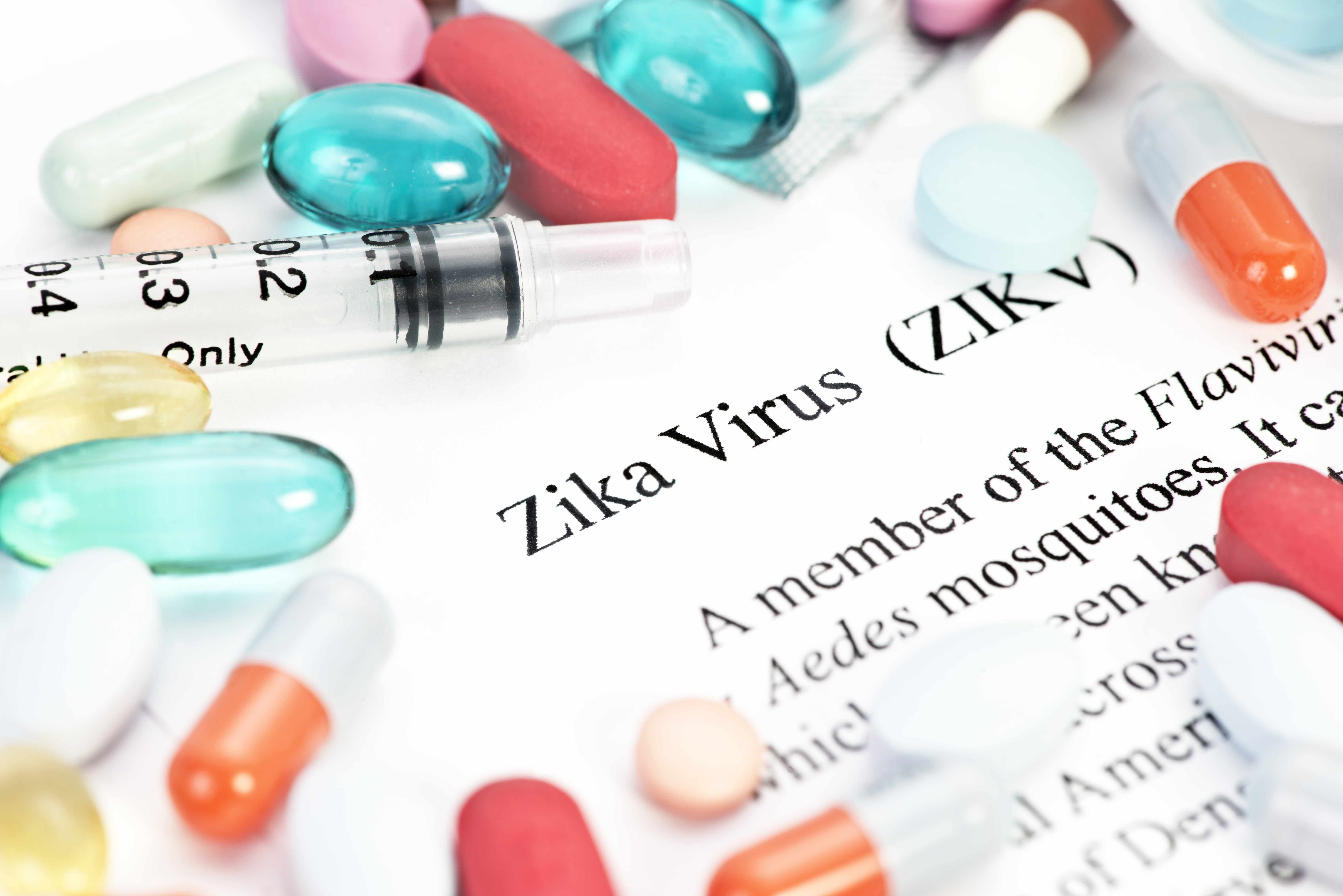 word definition of zika virus with a syringe and pills