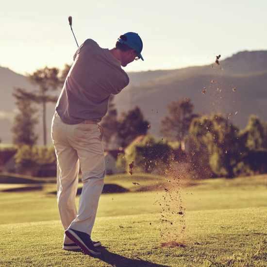 a golfer taking a full golf swing