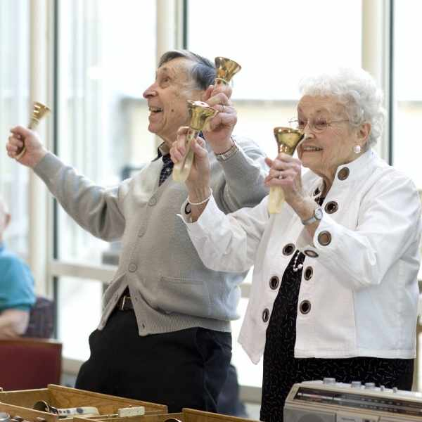 Marlow and Frances Cowan bell ringing and performing in the Gonda Lobby