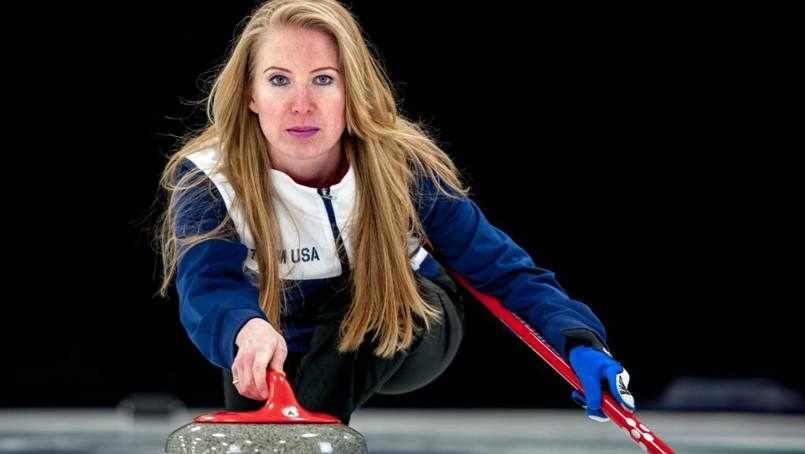 patient Regan Birr playing the game of curling on the ice