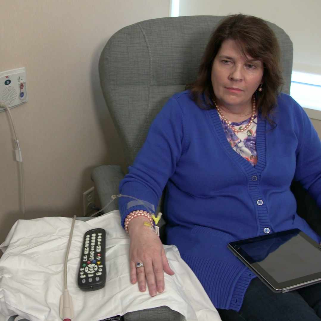Debra Wagner sitting and receiving therapy for melanoma