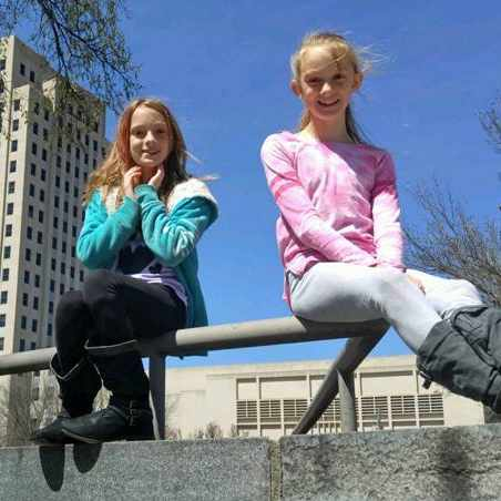 Twins Abby and Belle Carlsen outside in a park