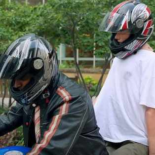 simulation mannequin Gus on a mototcycle with Dr. Pandian wearing helmets