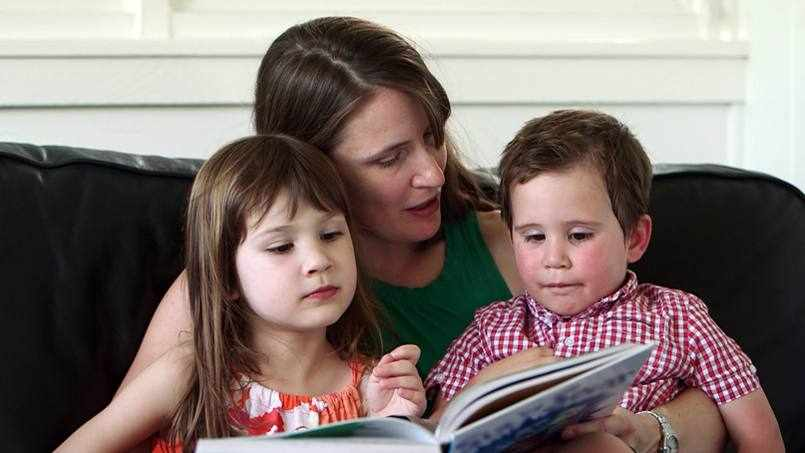 stroke patient Sherry reading a book with her two children