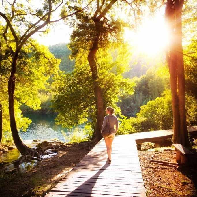 woman walking in the sunshine