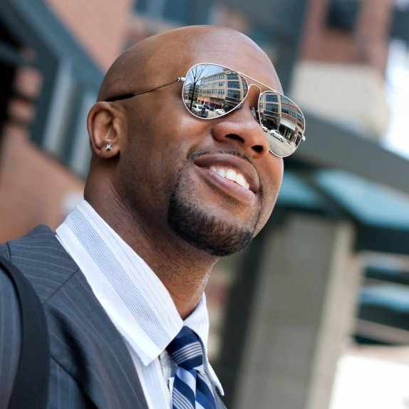 African-American businessman in a suit wearing sunglasses