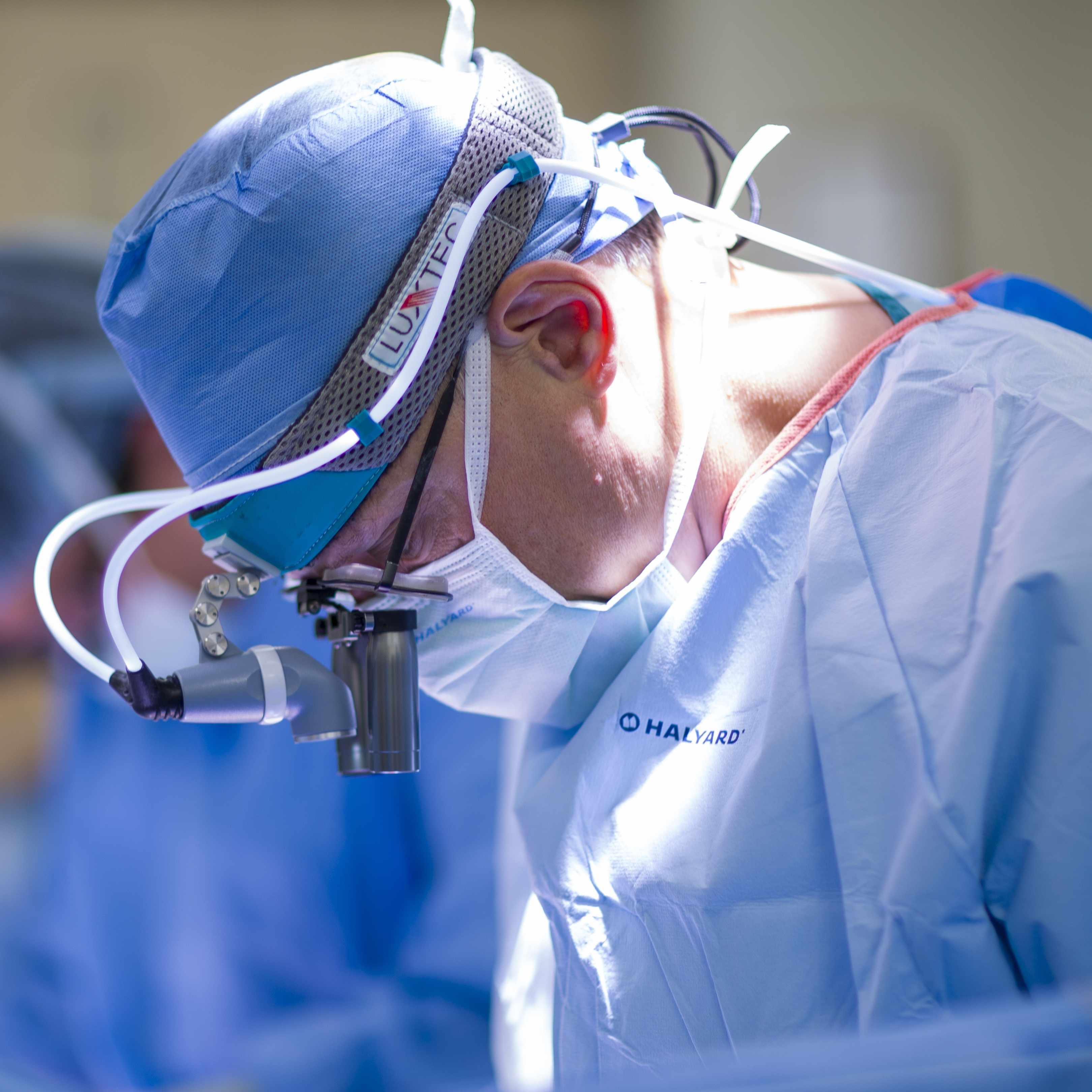 close-up of transplant surgeon performing surgery