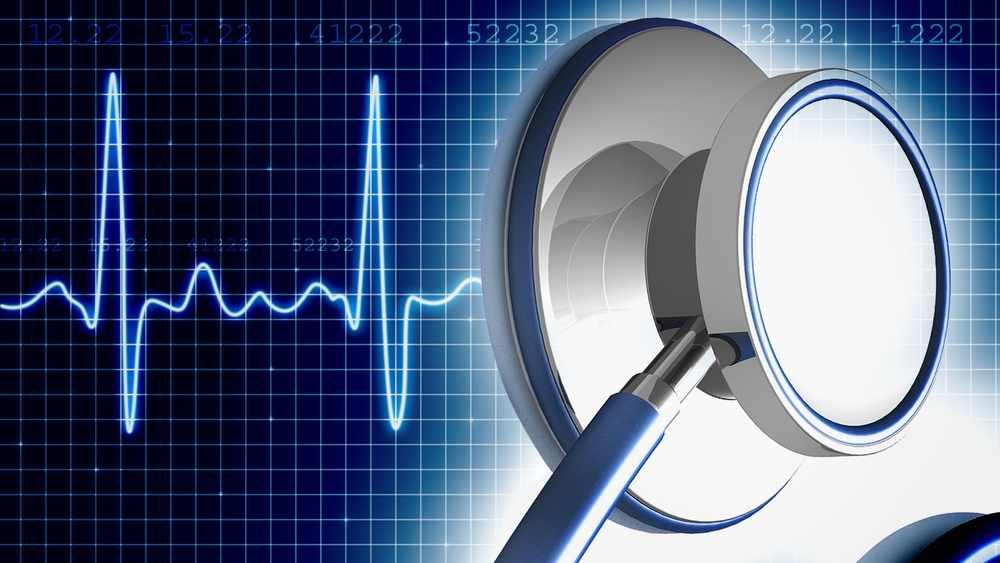 Gráfico de un estetoscopio y del latido cardíaco