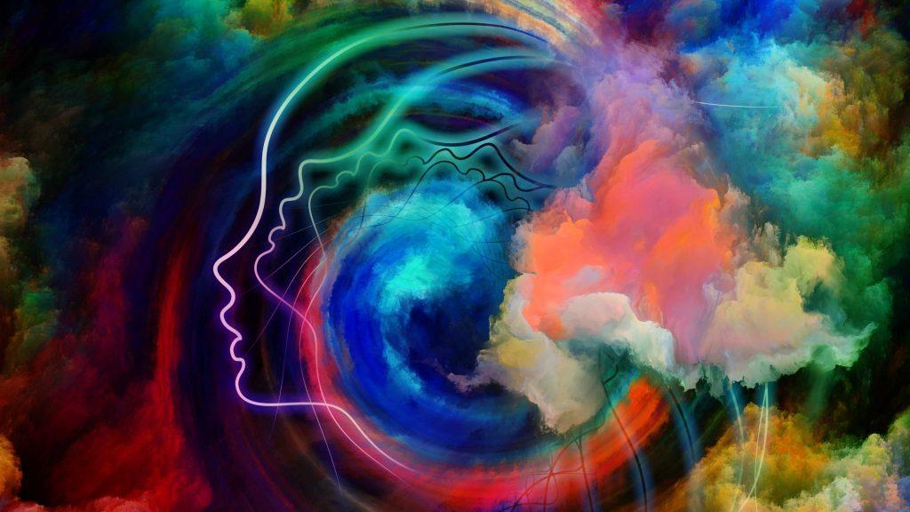 Dibujo de la cabeza de una persona con colores que representan la realidad interior, la salud mental, el pensamiento y los sueños