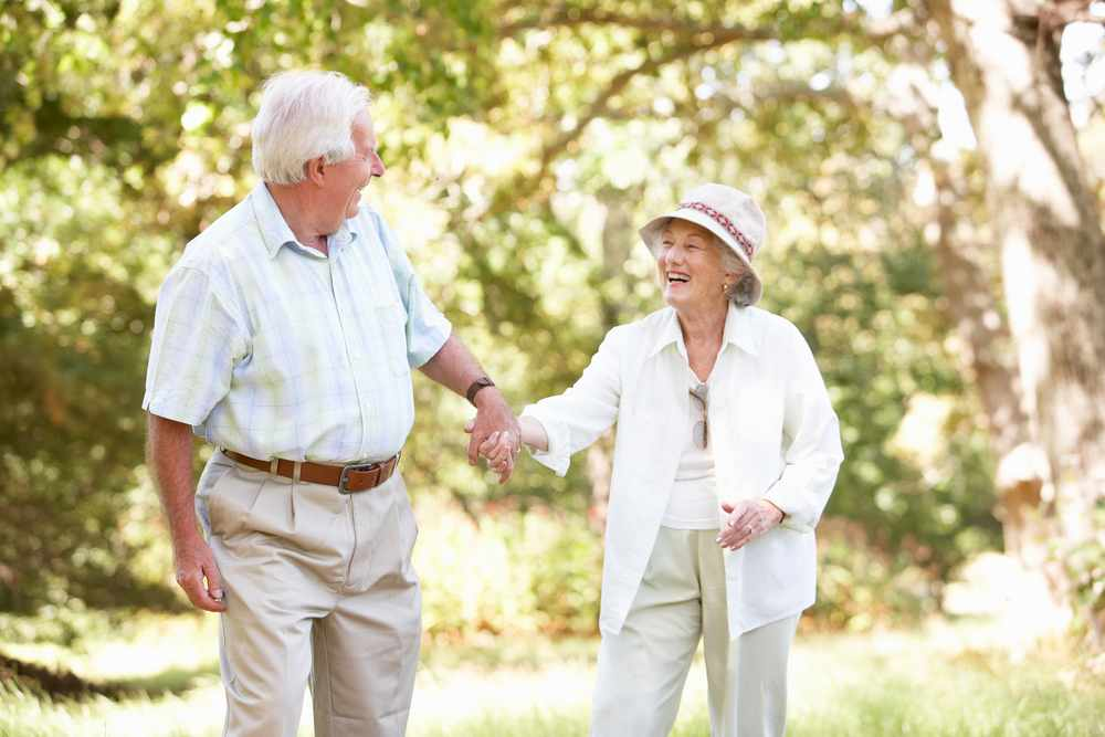 an older man and woman out for a walk