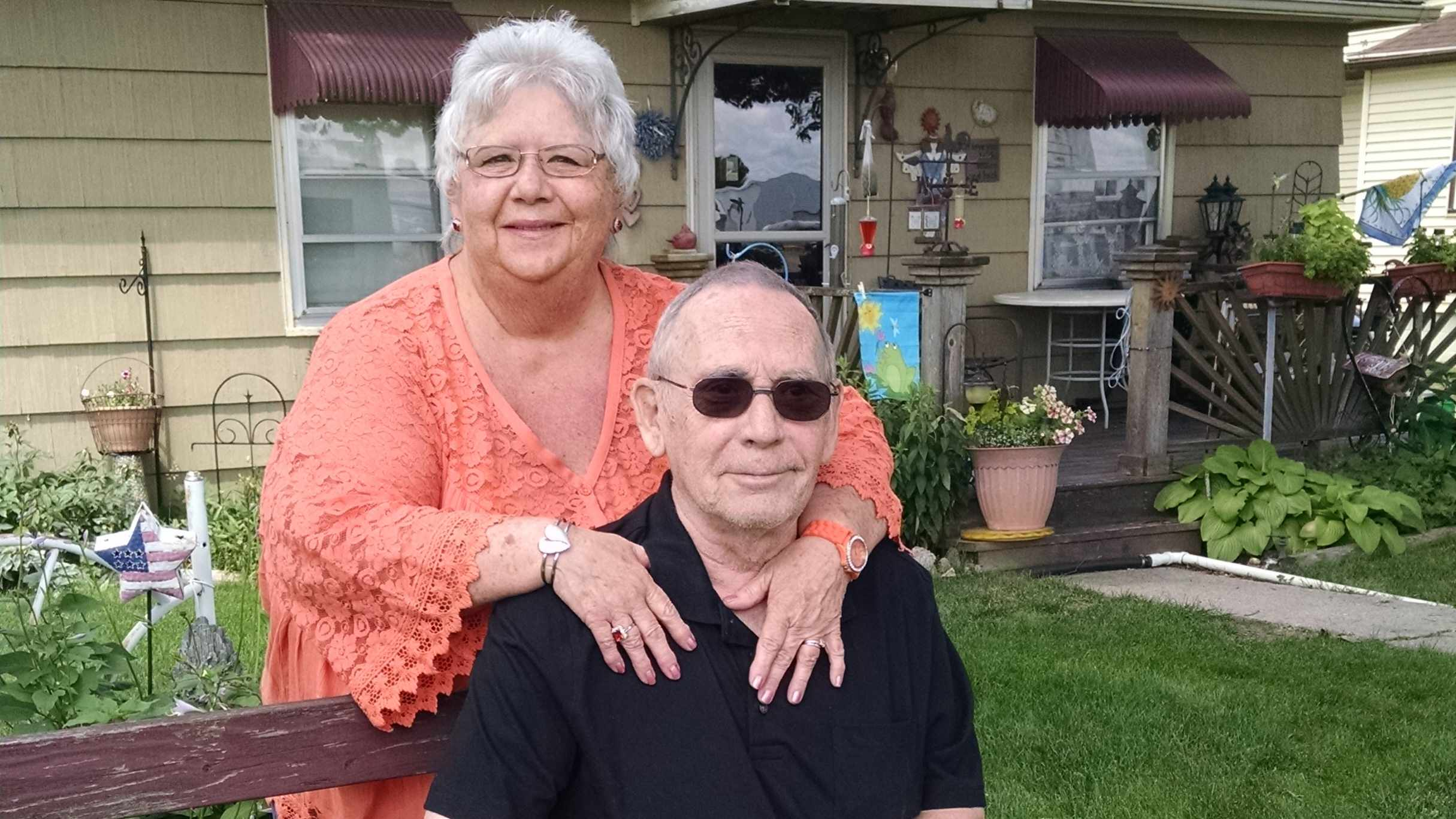 aortic aneurysm patient pictured with his wife outside their home 16x9