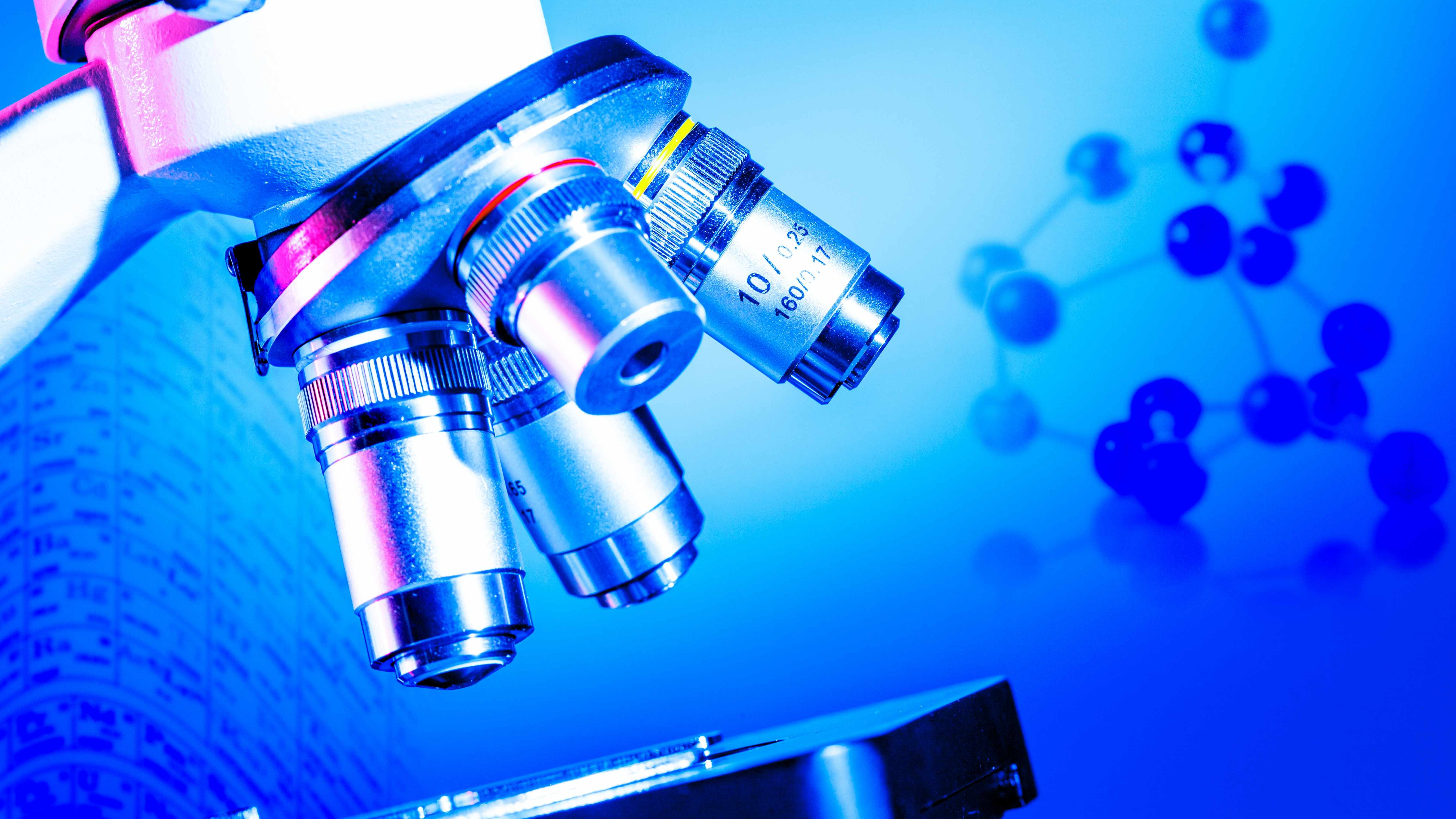 medical or chemistry science background with a microscope