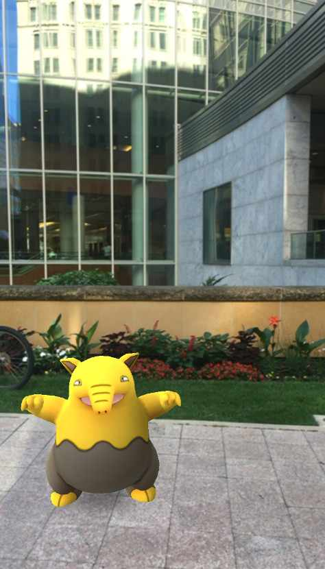 Pokeman game image with Gonda building in background