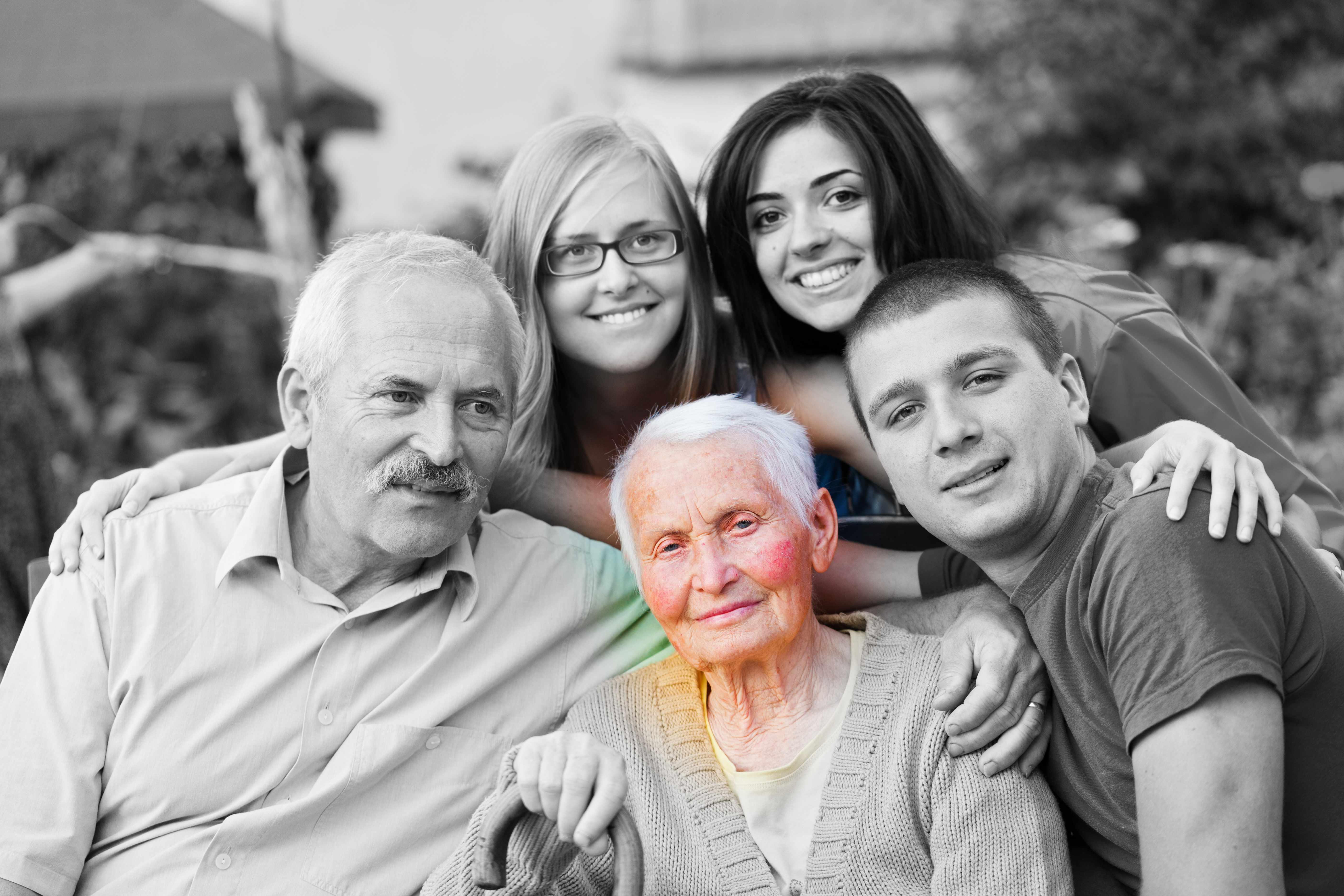 a black and white family picture with the older grandmother highlighted