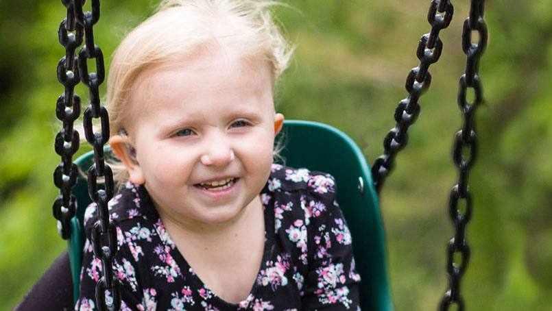 brain cancer pediatric patient Addyson Cordes in a swing
