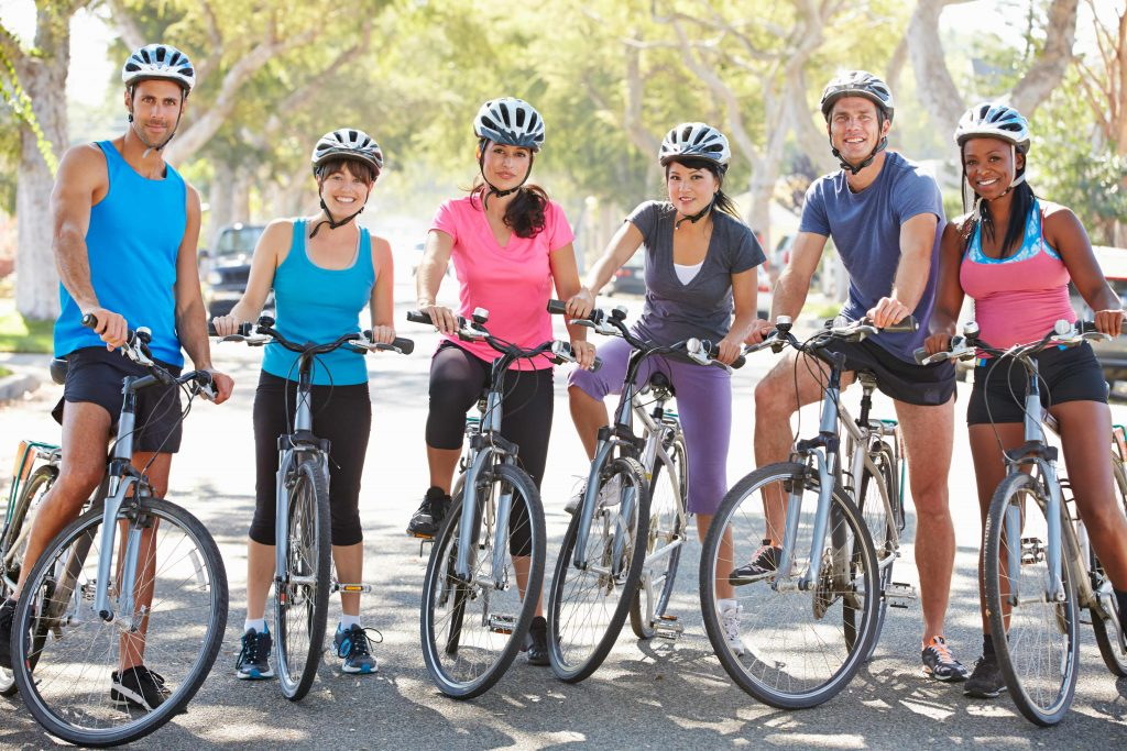 a group of young people getting ready for a bike ride