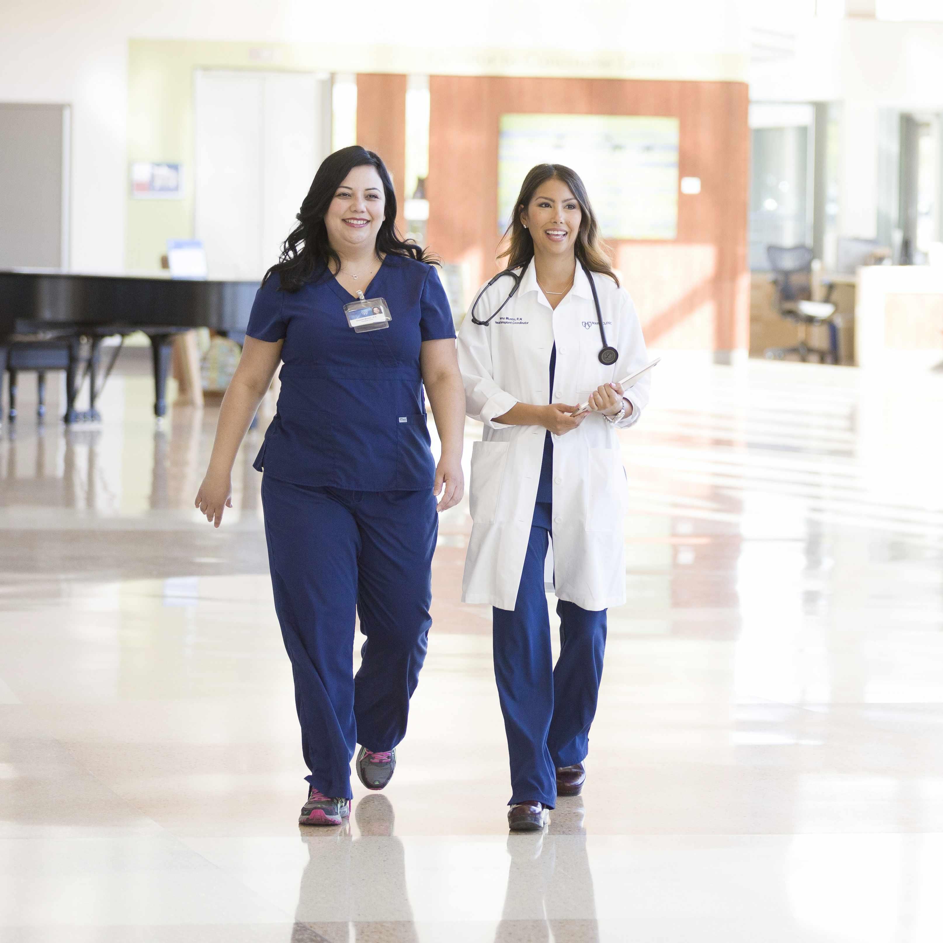 Mayo Clinic medical staff meeting walking in a hospital lobby