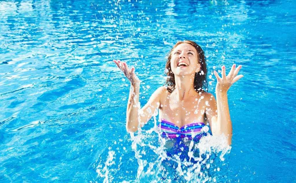 middle aged woman in swimming pool have fun in the water