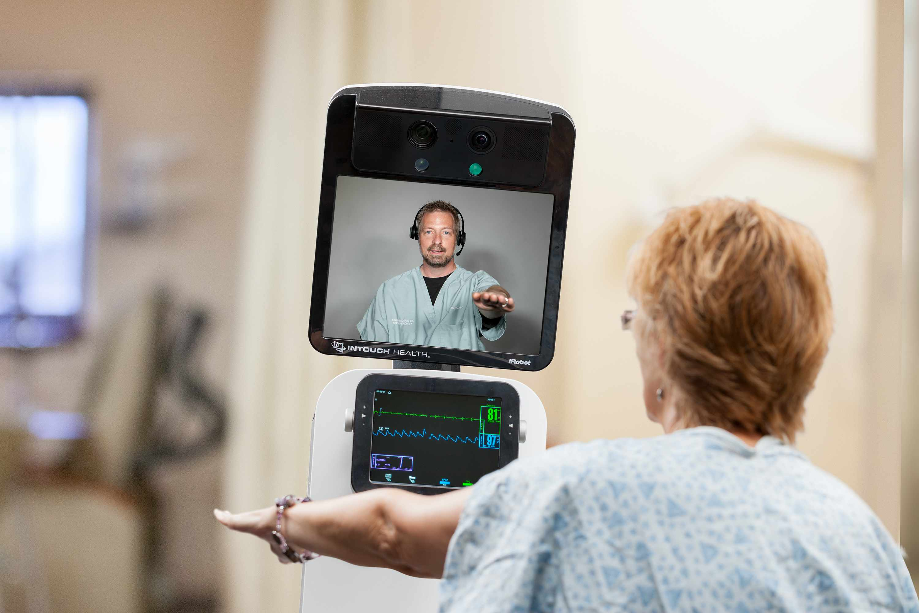 Patient looking at physician on telestroke machine