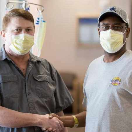 transplant patients Michael Tyler and William Tiger shaking hands