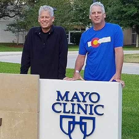 Berry brothers standing together by the Mayo Clinic sign