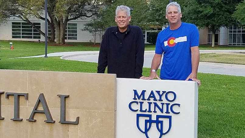 the Berry brothers standing together by the Mayo Clinic sign