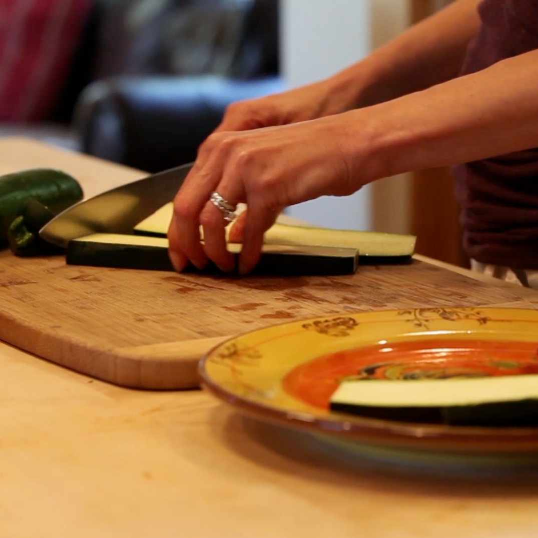 Person slicing vegetables