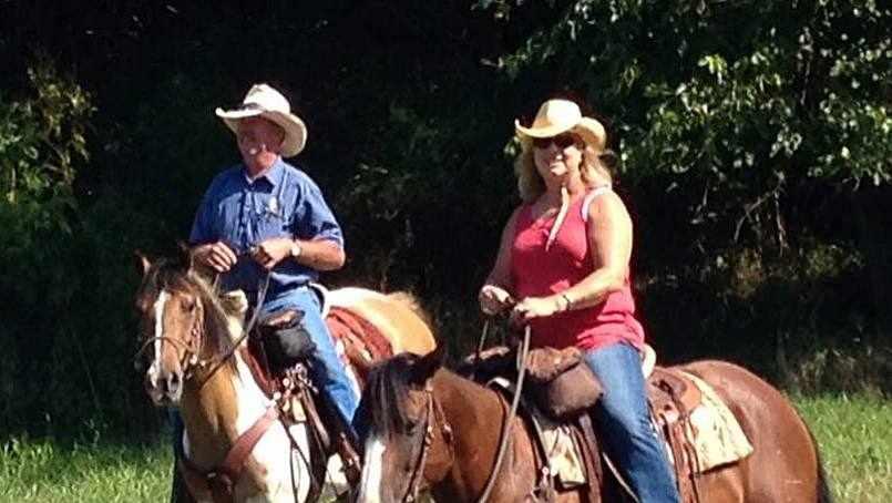 the Berrys riding on horseback