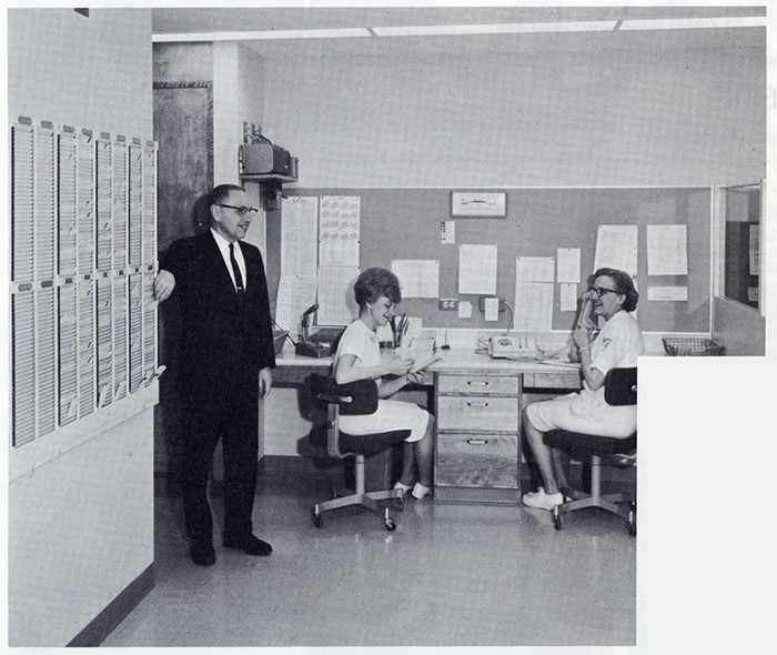 a 1967 photo of Dr. Gordon Martin, consultant in Physical Medicine; Ellen Mittelstadt, desk attendant; and Esther Swartz, Physical Therapy supervisor