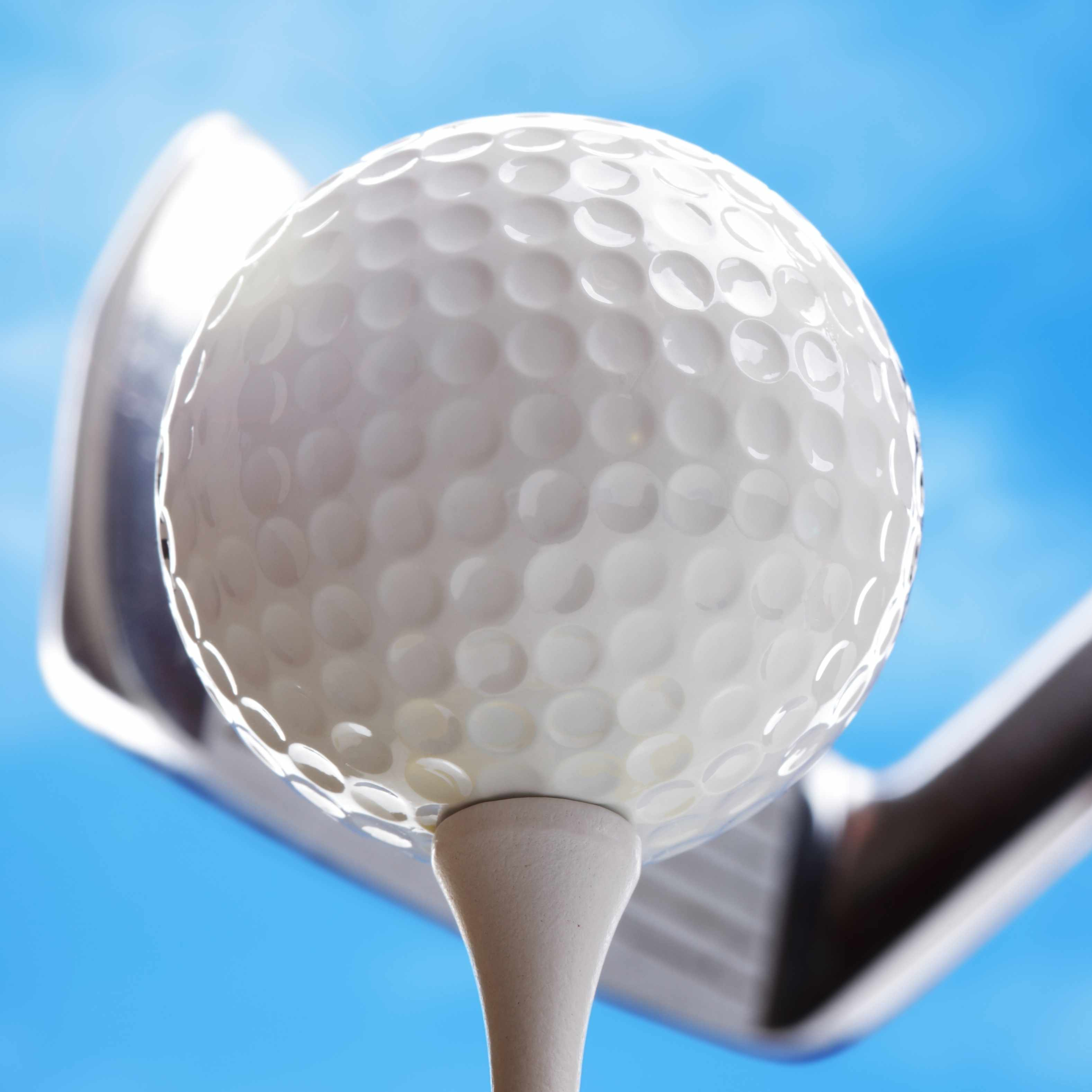 golf club and golf ball with blue sky background