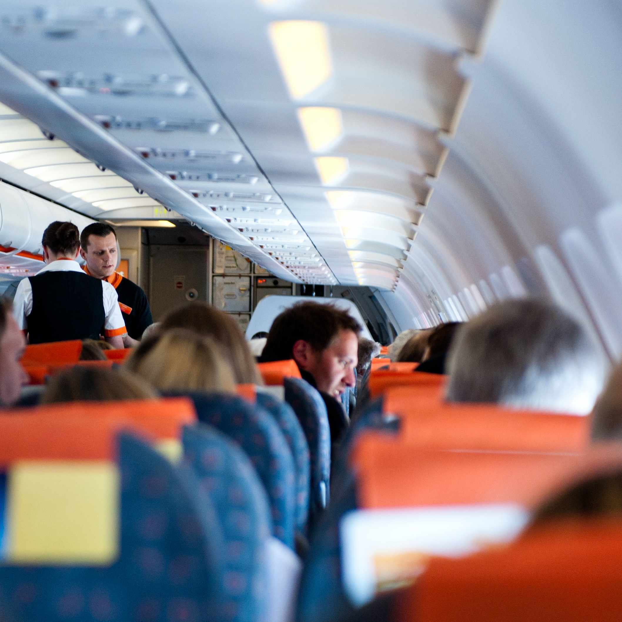 people sitting in their seats on a crowded plane