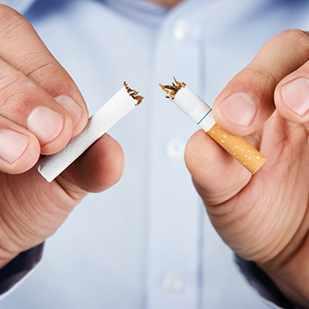 quit smoking, human hands breaking tobacco cigarette 1x1