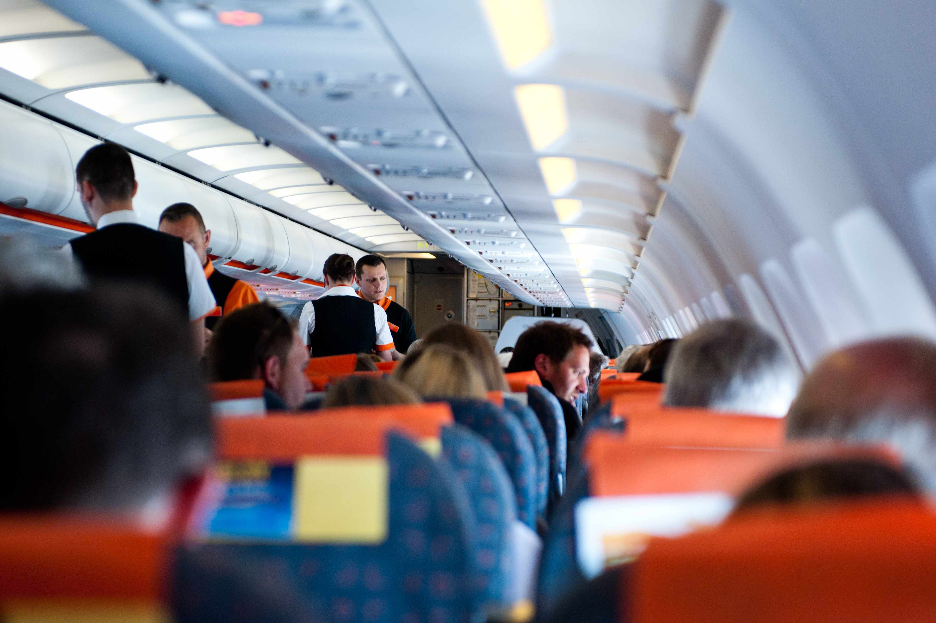 people sitting in their seats on a crowded airplane
