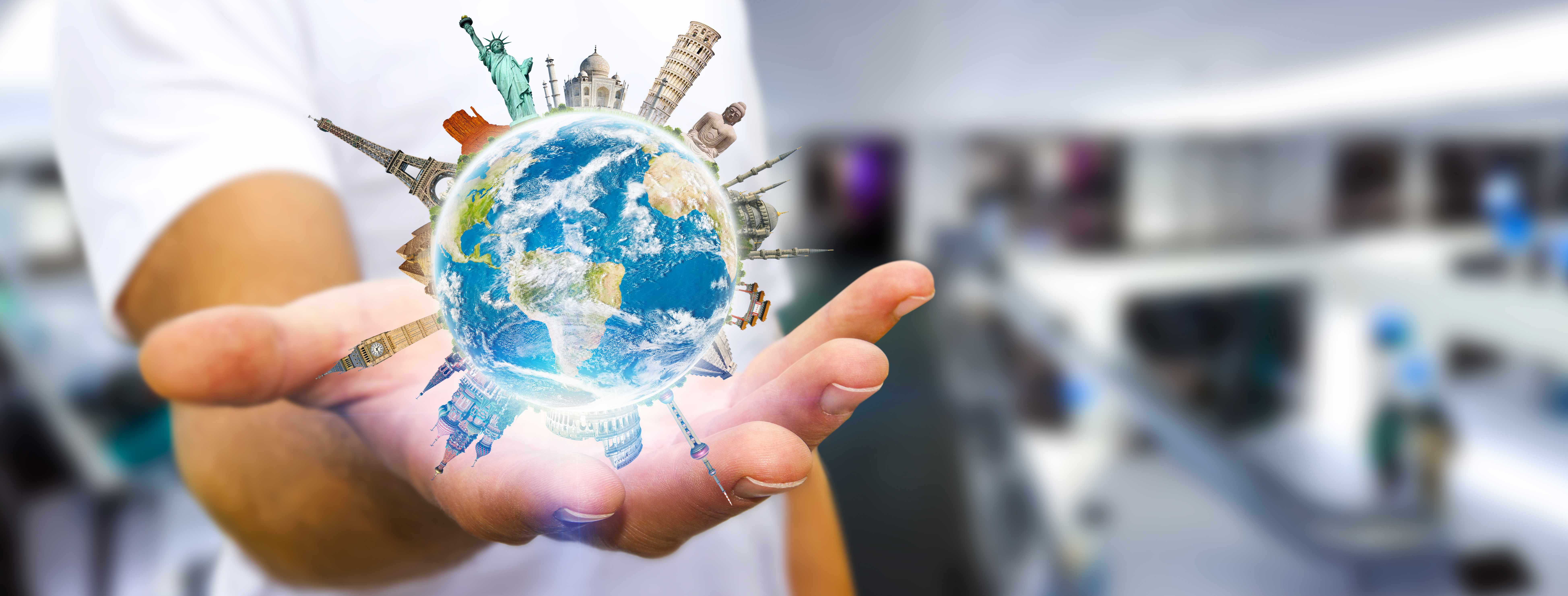 a person in a work office or lab balancing the world or globe in their hand