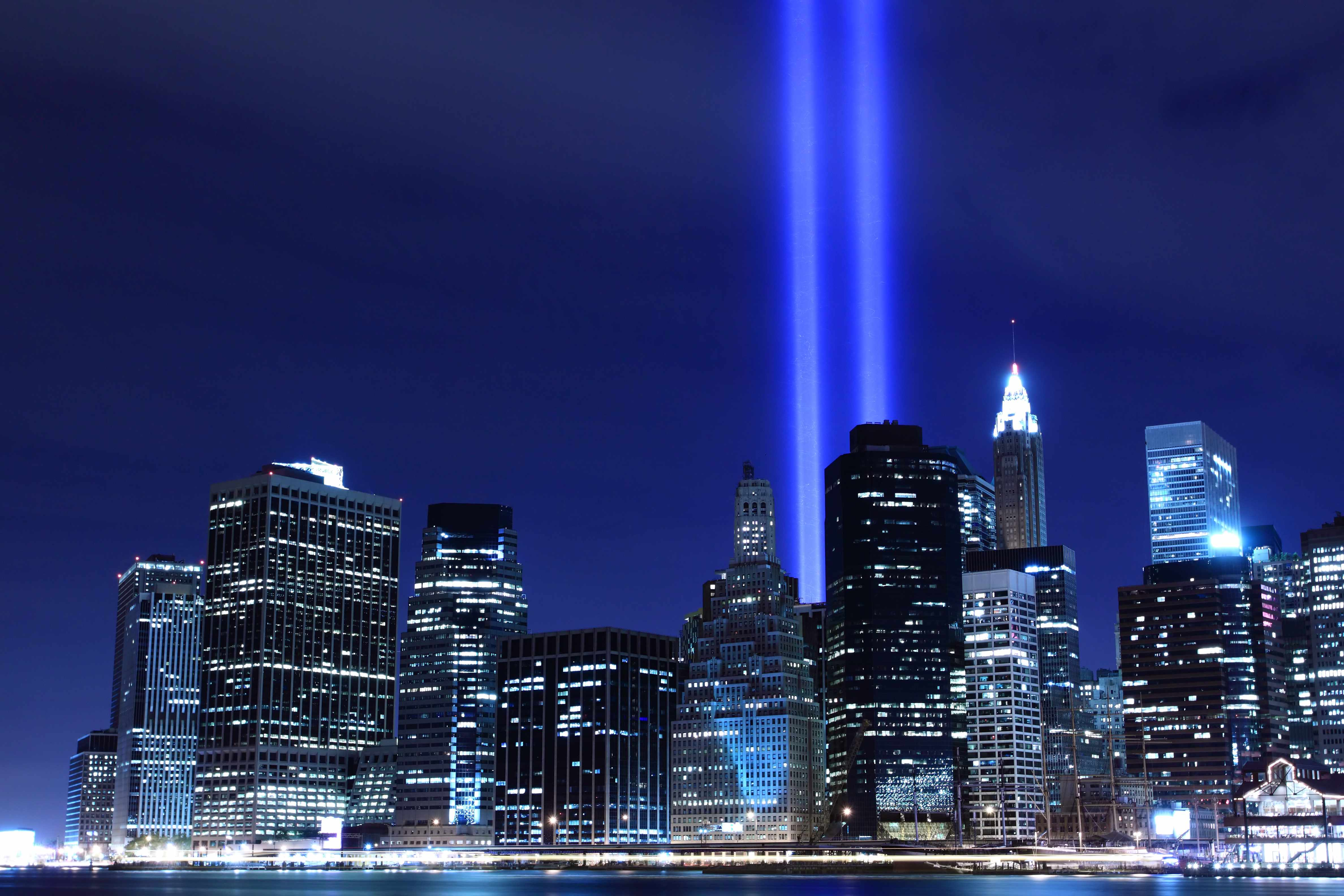 night skyline of New York City with two beams of light for 9-11 remembrance