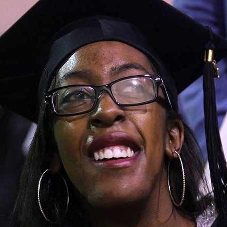 Sharing Mayo Clinic patient Brentney Simon wearing graduation cap
