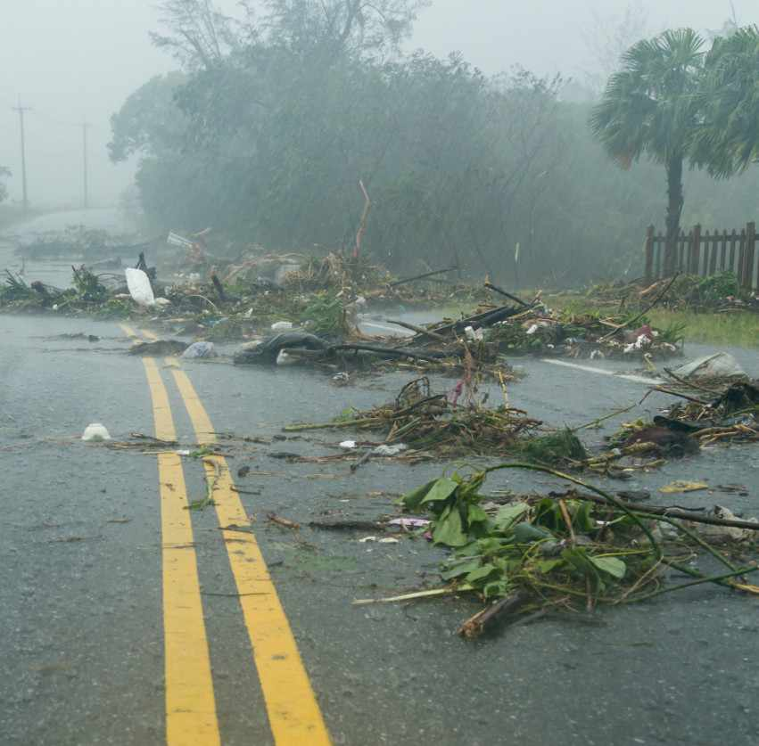debri-blocking-the-paved-road-after-a-heavy-rain-storm-or-hurricane